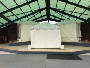small tents on a stage